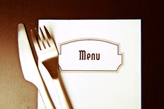 Menu. Silverware and a menu on a restaurant table Royalty Free Stock Photo