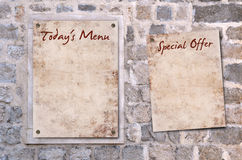 Menu. Two grunge posters on the stone wall to make a menu royalty free stock photography