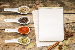 Menu background. Recipe notepad with diveristy of spices and herb. Royalty Free Stock Photography