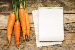 Menu background. Vegetables on table with cook book. Cooking with recipe book. Royalty Free Stock Image