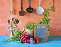 Menu black board, herbs,vegetables Royalty Free Stock Photo