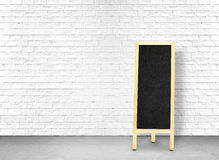 Menu black board at White brick wall and cement floor,leave spac Royalty Free Stock Photo