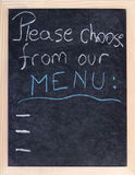 Menu on blackboard Stock Photography