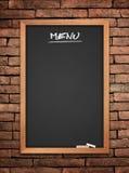 Menu blackboard. On wall Brick mortar background stock photography