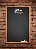 Menu blackboard. On old wall Brick mortar background Stock Images