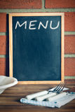 Menu blackboard before brick wall Stock Image
