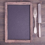 Menu blackboard  with knife and fork Royalty Free Stock Photography