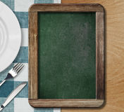 Menu blackboard lying on table Stock Image