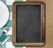 Menu blackboard lying on table. Top view Royalty Free Stock Images