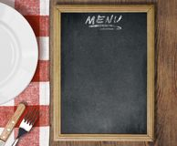 Menu blackboard top view on table with dish, knife. Menu chalkboard top view on table with dish, knife and fork Stock Photos