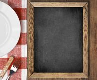 Menu blackboard top view on table with plate,. Menu chalkboard top view on table with plate, knife and fork Stock Photo