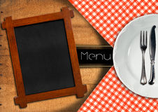 Menu with Blackboard and White Plate Stock Image