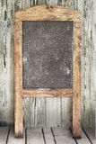 Menu blackboard on wooden wall Royalty Free Stock Photos