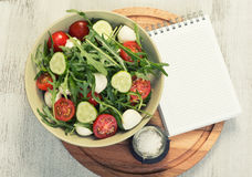 Menu. blank notepad and vegetable salad Royalty Free Stock Images
