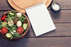 Menu. blank notepad and vegetable salad Royalty Free Stock Photo