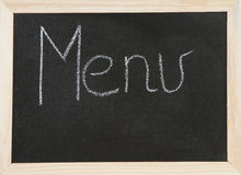 Menu on board. Black chalk board with wooden framed surround with the word Menu Royalty Free Stock Photos