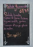 Menu board with advertisement at a French restaurant Royalty Free Stock Images