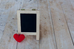 Menu board in black and red hearts placed on a wooden floor. Royalty Free Stock Photo