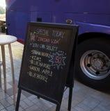 Menu board. A black menu board on sidewalk Stock Photos