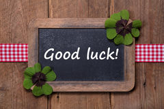 Menu board with clovers and good luck message with wood stock image