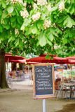 Menu on board in French outdoor restaurant Stock Photo