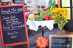 Menu board of French restaurant. Menu board with arrangement of vegetables and sunflower at French restaurant Royalty Free Stock Photo