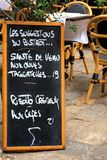 Menu board at French restaurant Royalty Free Stock Image