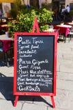 Menu board at an Italian restaurant in an Italian town Stock Image