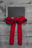 Menu board with a red ribbon for message with red knitted bow Royalty Free Stock Photo