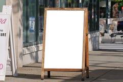 Menu Board on Sidewalk Royalty Free Stock Image