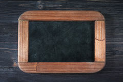 Menu board on a wooden background Stock Image