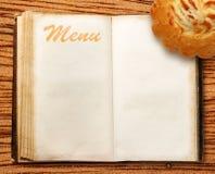 Menu book with cake Stock Image