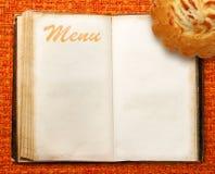 Menu book with cake Royalty Free Stock Photo