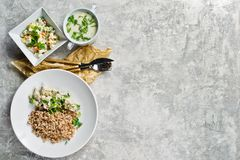 Menu business lunch restaurant, beef Stroganoff, green salad and chicken soup. Gray background, top view stock photo