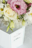 Menu card with beautiful flowers on table in wedding day Stock Photo