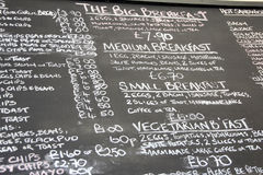 Menu chalk blackboard. Photo of a cafe menu blackboard showing food items and prices Royalty Free Stock Photo