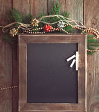 Menu chalkboard in a Christmas atmosphere. Celebration decorative christmas set with a chalkboard fir tree branch and sparkling beads Stock Photography