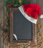 Menu chalkboard in a Christmas atmosphere. Royalty Free Stock Photography