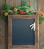 Menu chalkboard in a Christmas atmosphere. Celebration decorative christmas set with a chalkboard fir tree branch and sparkling beads Royalty Free Stock Photography