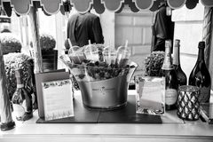 Menu, champagne bottles, fresh berries on ice and coctails. Paris, France - June 01, 2017: menu, champagne bottles, fresh berries on ice and coctails on table Royalty Free Stock Photos