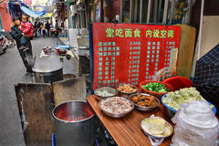 Menu in cheap street eatery in Shanghai. Menu pricelist in cheap outdoor eatery in Shanghai Royalty Free Stock Photos