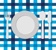 Menu design with cutlery on blue tablecloth Royalty Free Stock Image