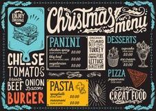 Menu di Natale per il ristorante e caffè su una lavagna illustrazione di stock