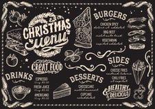 Menu di Natale per il ristorante e caffè su una lavagna royalty illustrazione gratis