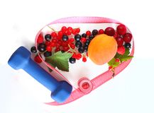 Menu diet plan or program, tape measure, dumbbells and diet food fresh fruits on a white background. Royalty Free Stock Photography