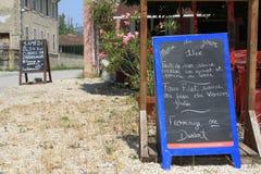Menu du Jour restaurant sign Southern France. Plus Samedi sign for Grenouilles Royalty Free Stock Image