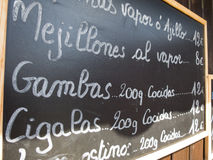 Menu espagnol de mollusques et crustacés Images stock