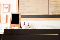 Menu frame on counter in cafe Royalty Free Stock Images