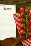 Menu and fresh tomatoes on wooden Royalty Free Stock Image