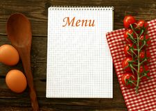 Menu and fresh tomatoes on wooden boards Stock Image